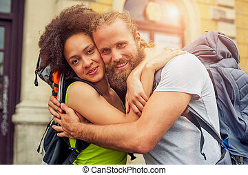 Closeup of beautiful couple of tourists in love