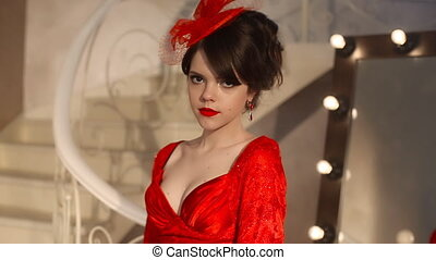 Closeup of beautiful fashion young girl in retro hat and red...