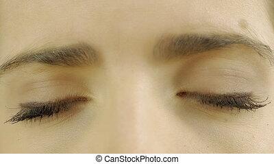 Closeup of beautiful sad brown female eyes 4K