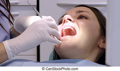 woman at dental studio - Closeup of beautiful woman at...