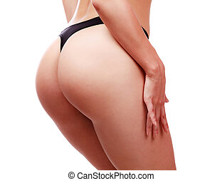 Closeup of beautiful woman buttocks in lingerie. Female ass in black panties. Isolated on white background