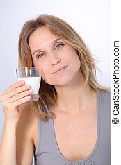 Closeup of beautiful woman drinking milk