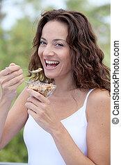 Closeup of beautiful woman eating cereals