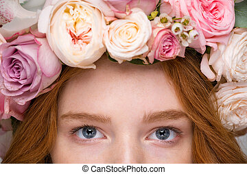 Closeup of beautiful woman eyes in flower wreath
