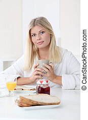 Closeup of beautiful woman having breakfast