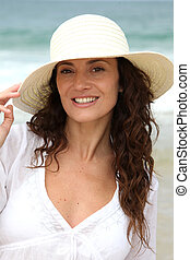Closeup of beautiful woman wearing straw hat