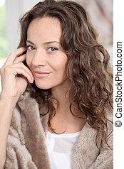 Closeup of beautiful woman with fur