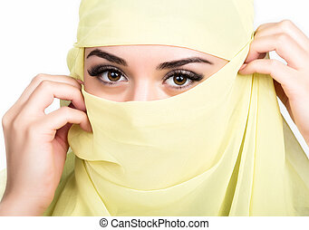Closeup of beautiful young arabian woman in yellow hijab....