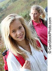 Closeup of beautiful young girl on hiking day