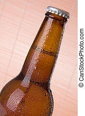 closeup of brown beer bottle