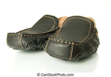 Closeup of black mens shoes moccasins