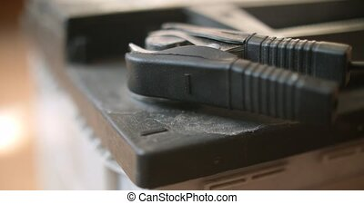 Closeup of black minus sign accumulator car battery charger clamp