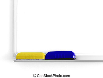 Closeup of blank whiteboard with yellow and blue cleaning...