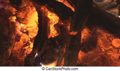 closeup of blaze in campfire - blaze in campfire fanned by...