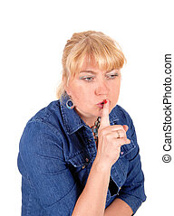 Closeup of blond woman with finger over mouth.