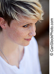 Closeup Of Blond Woman With Nose Piercing