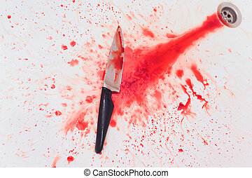 Closeup of bloody knife with splattered blood in the sink. Concept of Halloween horror.