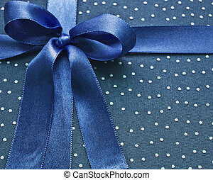 Closeup of blue bow on blue fabric
