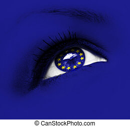 blue eye with european union flag - closeup of blue eye with...