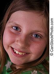 Closeup of blue eyed girl smiling