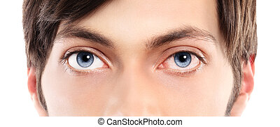 Closeup of blue eyes from a young man red and irritated eye with blood vessels