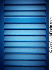 Closeup of blue wood shutters planks texture background