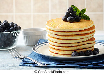 closeup of blueberry pancakes with a fork