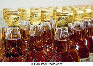 bottles of scotch blended whisky - closeup of bottles of ...