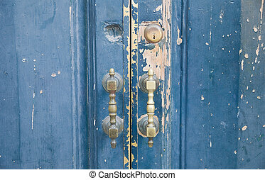 Closeup of brass handle of allwood door.