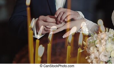 closeup of bride and groom exchanging wedding rings