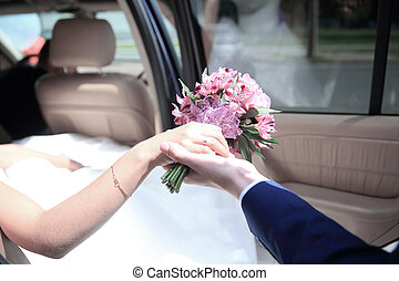 bride and groom sitting in the car