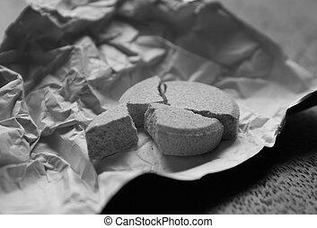 closeup of broken pill