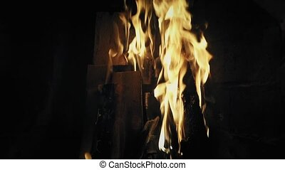Closeup of burning fire in a home fireplace. Slow mo, closeup