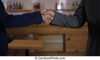Closeup of business handshake after successful deal