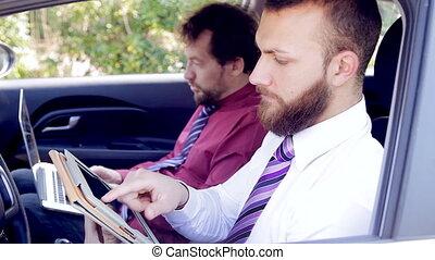 Closeup of business men in car