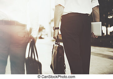 Closeup of business people holding bag
