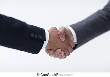 Closeup of business people shaking hands over a deal -...