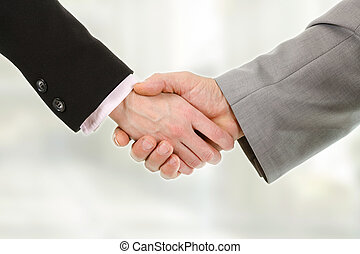 Closeup of business people shaking hands with each other