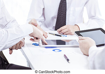 business team with digital tablet and smartphone working with financial charts