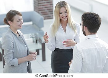 closeup of business woman talking with a colleague -...