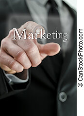 Closeup of businessman finger pushing Marketing button on a touch screen interface.