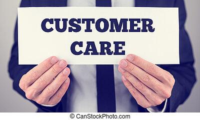 Customer care - Closeup of businessman holding white card ...