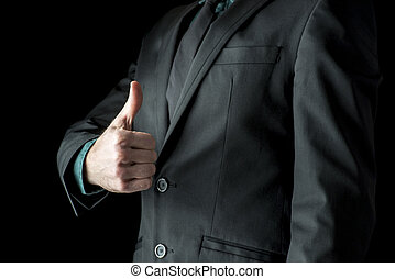Closeup of businessman showing a thumbs up sign