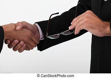Closeup of businessmen shaking hands