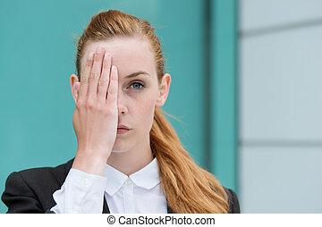 Closeup Of Businesswoman Covering Eye