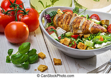 Closeup of caesar salad and fresh ingredients