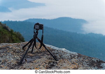 closeup of camera take a photo on mountain