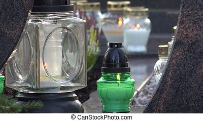 closeup of candle lantern on the stone grave. 4K