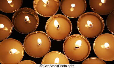 Closeup of Candle lights on dark background