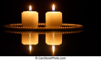 Closeup of candles on black